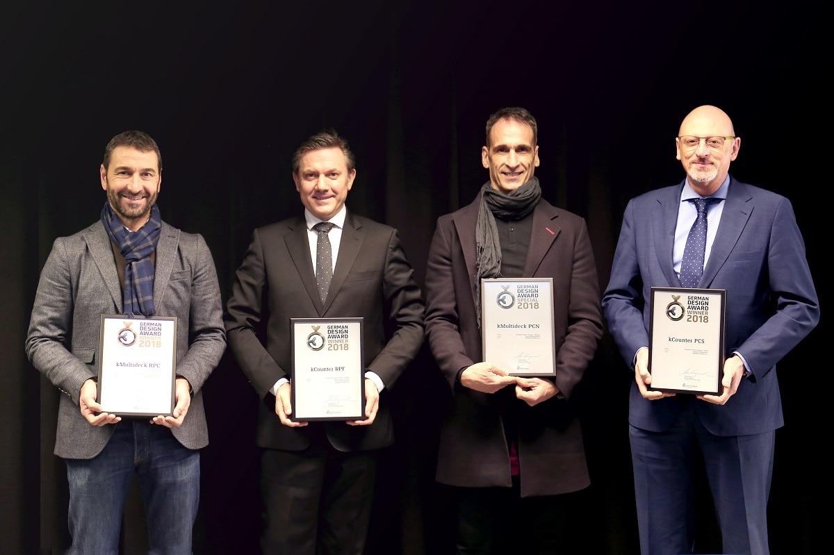 Responsables de Kgroup con los reconocimientos obtenidos por su marca Koxka en Alemania.